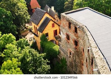 ZAGORZE SLASKIE, LOWER SILESIA, POLAND - SEPTEMBER 6: Grodno Castle (formerly Kynsburg) on September 6, 2017 in Zagorze Slaskie, Poland. Ruins of the medieval castle and gatehouse building aerial view