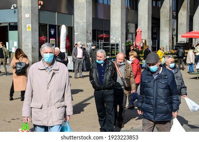 Zagreb, 20 Feb 2021: Senior people walking on street and wearing a face mask to protect themselves from epidemic of coronavirus. Covid-19 protection. Elderly people with medical mask in the park. 2019