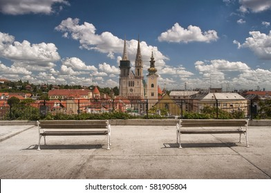 Zagreb Cathedral and city skyline with empty benches in foreground as seen from Gradec, Zagreb