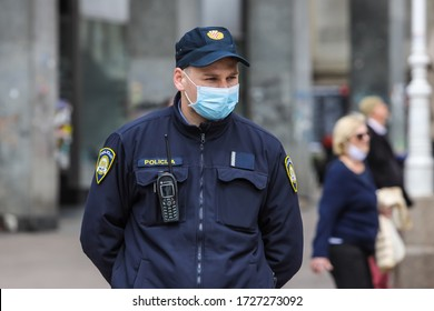 Zagreb, Croatia - 01 May, 2020 : Policeman wears a protective medicine mask because of coronavirus on the streets of Zagreb, Croatia.