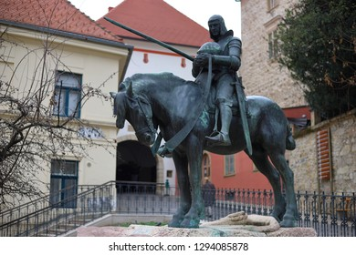 ZAGREB, CROATIA - 01/20/2019: Statue of Saint George slaying the dragon in front of one of the most notable Zagreb landmarks, the Stone Gate (Kamenita vrata) at the Upper town.