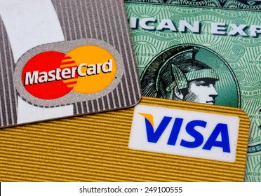 ZAGREB , CROATIA - 02 FEBRUARY 2015 - close up of pile credit cards with master card, VISA and american express logo on the credit card , product shot