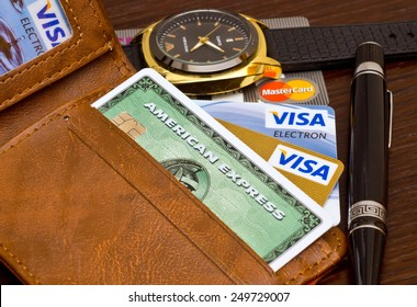 ZAGREB , CROATIA - 02 FEBRUARY 2015 - close up of credit cards , master card, VISA and american express in the leather wallet , product shot
