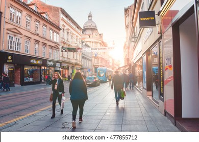 ZAGREB, CROATIA - 1 APRIL 21016: Busy street in Zagreb with dramatic sunlight. ( Lens flare is done on purpose)