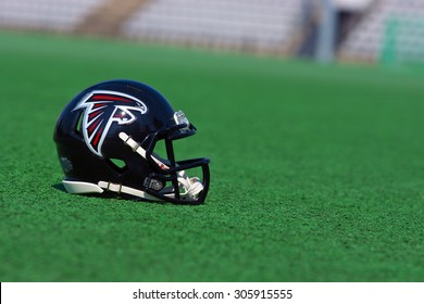 ZAGREB , CROATIA - 13 AUGUST 2015 -  Atlanta Falcons NFL club helmet on the green playing field , product shot