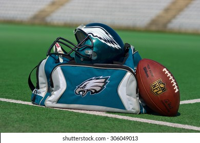 ZAGREB , CROATIA - 13 AUGUST 2015 -  Philadelphia eagles NFL club equipment , ball, bag and helmet on the green playing field , product shot