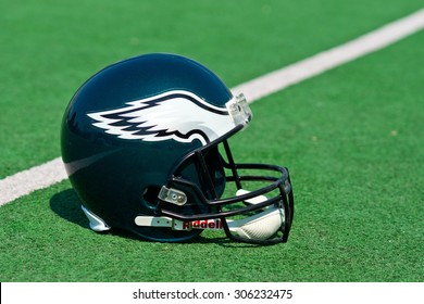 ZAGREB , CROATIA - 13 AUGUST 2015 -  Philadelphia eagles NFL club helmet on the green playing field , product shot