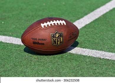 ZAGREB , CROATIA - 13 AUGUST 2015 -  official ball of the NFL football league , the Duke on grass turf background , product shot