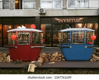 ZAGREB, CROATIA - 14 FEBRUARY 2019: Old ski cabins refurbished as seating area on cafe terrace.