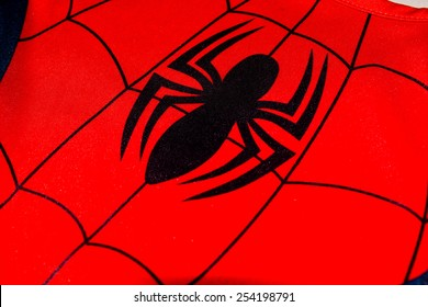 ZAGREB , CROATIA - 19 FEBRUARY 2015 - close up spiderman logo printed on his costume shirt, product shot