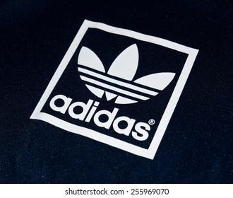 ZAGREB , CROATIA - 19 FEBRUARY 2015 - Close up logo of sport brand Adidas printed on textile , product shot