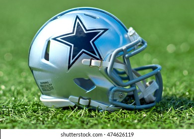 ZAGREB , CROATIA - 27 AUGUST 2016 - NFL Dallas Cowboys replica helmet on artificial grass playing turf , product shot