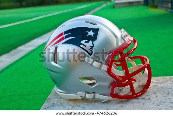 ZAGREB , CROATIA - 28 OCTOBER 2015 -  New England Patriots NFL club replica helmet at the green playing field , product shot