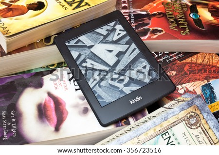 ZAGREB , CROATIA - 30 DECEMBER 2015 - Amazon Kindle e book reader on the pile of books, product shot