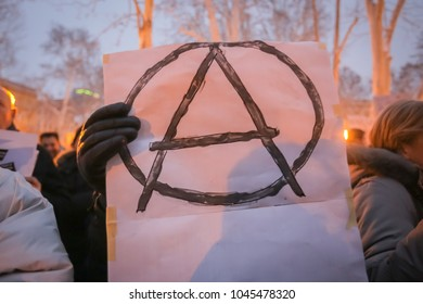 ZAGREB, CROATIA - 3rd MARCH, 2018 : Woman holds an anarchy sign on protest against the financial enforcement law that is terrorizing financially blocked people, in Zrinjevac Park, Zagreb, Croatia.