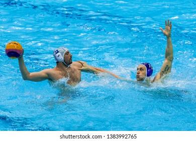 ZAGREB, CROATIA - APRIL 05, 2019: FINA Water Polo WORLD LEAGUE EUROPA CUP 2019. Italy vs Russia. In action PRESCIUTTI Nicholas (9) and KHOLOD Dmitrii