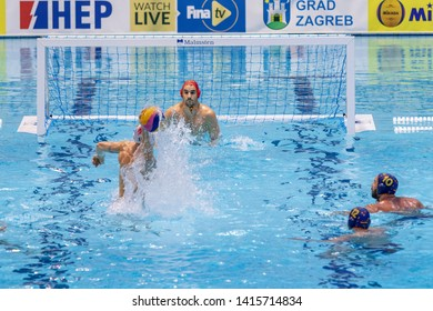 ZAGREB, CROATIA - APRIL 07, 2019: FINA Water Polo WORLD LEAGUE EUROPA CUP 2019. Italy vs. Spain. In action FIGLIOLI Pietro (4) (C) shoots on the goal