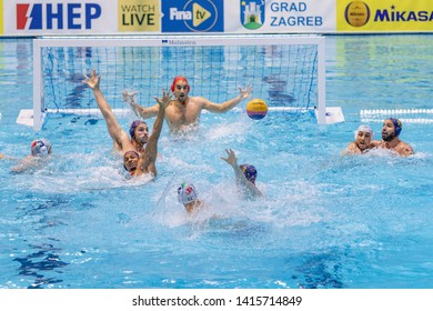 ZAGREB, CROATIA - APRIL 07, 2019: FINA Water Polo WORLD LEAGUE EUROPA CUP 2019. Italy vs. Spain. In action FIGLIOLI Pietro (4) (C) shoots on goal