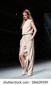 "ZAGREB, CROATIA - APRIL 09: Fashion model wears clothes made by Arileo on ""CRO A PORTER"" show on April 09, 2014 in Zagreb, Croatia."
