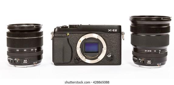 ZAGREB, CROATIA - APRIL 30,2015:  Photo of FUJIFILM X-E2 mirrorless camera with FUJINON LENS XF18-55mm F2.8-4 AND 10-24mm F4  on white