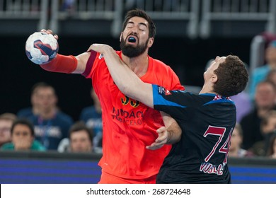 ZAGREB, CROATIA - APRIL 9, 2015: EHF Men's Champions League - Quarter final match between HC Zagreb PPD and HC Barcelona. KARABATIC Nikola (33) and VUGLAC Mario (74).