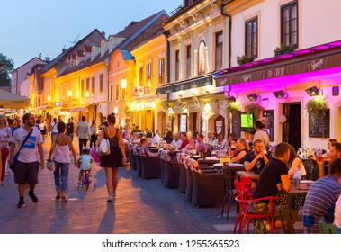 ZAGREB, CROATIA - AUG 25, 2017: Locals and tourists having a dinner at restaurants at Ivana Racica street. Zagreb is a capital and famous tourist destination in Croatia