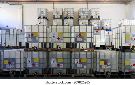 ZAGREB, CROATIA - AUGUST 08, 2014: IBC Containers with highly flammable chemical liquids in warehouse. Containers have ADR symbols of 3rd. category on it