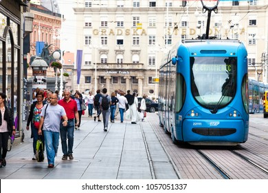 ZAGREB, CROATIA. August 17, 2015: Zagreb, Croatia. Tram in the historic center of the city with the population and tourists walking on the street.