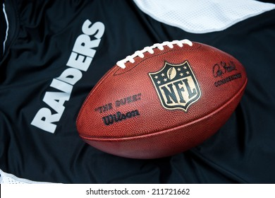 ZAGREB , CROATIA - AUGUST 19 , 2014 :  NFL Oakland Raiders club equipment with NFL official ball, product shot