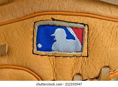ZAGREB , CROATIA - AUGUST 19 , 2014 :  MLB logo on baseball leather glove close up , product shot