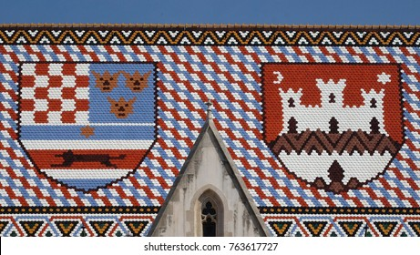 ZAGREB, CROATIA - AUGUST 19: Coat of arms of the Kingdom of Croatia, Slavonia and Dalmatia and the City of Zagreb, checkered tiled rooftop of St Mark's church in Zagreb, Croatia on August 19, 2017.