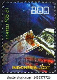 ZAGREB, CROATIA - AUGUST 2, 2019: a stamp printed in Indonesia dedicated to philately, Indonesia post in the 21st century, circa 2000