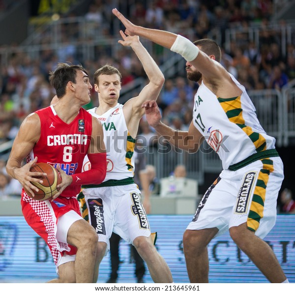 ZAGREB, CROATIA - AUGUST 26, 2014: Friendly basketball game - Croatia vs Lithuania. Dario SARIC (8) and Jonas VALANCIUNAS (17)