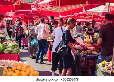 ZAGREB, CROATIA - AUGUST 26, 2015: Customers and sellers at Dolac, the famous open air farmer's market of agricultural products in Zagreb, one of city's most notable landmarks.