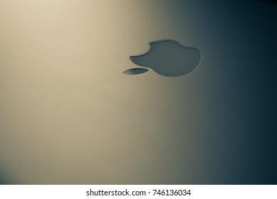 Zagreb, Croatia - August 9, 2015: White Apple logo on brushed aluminium background.