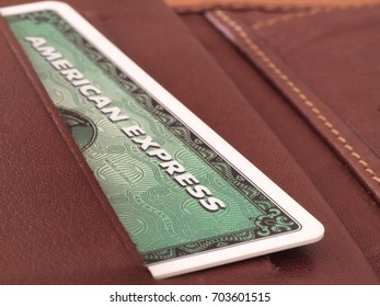 ZAGREB, CROATIA - AUGUST 9, 2017: Green American express card in wallet. American express is one of most popular credit cards worldwide.