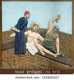 ZAGREB, CROATIA - DECEMBER 01, 2016: 11th Stations of the Cross, Crucifixion: Jesus is nailed to the cross, church of Immaculate Conception of the Virgin Mary in Malesnica, Zagreb, Croatia