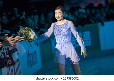ZAGREB, CROATIA - DECEMBER 17, 2013: Yuna KIM receiving flowers from supporters at Gala revue of 46th Golden Spin of Zagreb, the oldest skating competition in the world.