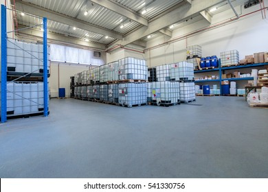 ZAGREB, CROATIA - DECEMBER 21, 2016: Warehouse with chemicals in IBC containers. IBC is used for storage and transport of chemicals.