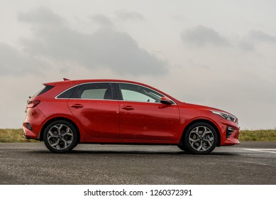 ZAGREB, CROATIA - DECEMBER 22, 2018: New Kia Ceed in red colour. Brand new car.  View from the side.