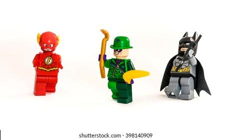 ZAGREB, CROATIA - DECEMBER 25, 2015: Lego toys Batman, Riddler and Flash from DC universe. Studio shot on white background.