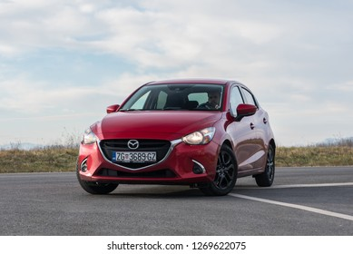 ZAGREB, CROATIA - DECEMBER 26, 2018: New Mazda 2 in Soul Crystal red colour on the streets. Front view of the car.