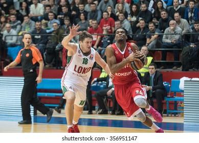 ZAGREB, CROATIA - DECEMBER 30, 2015: Basketball Euroleague - Cedevita Zagreb VS Lokomotiv Kuban Krasnodar. James, WHITE with the ball and Evgeny VORONOV (18).