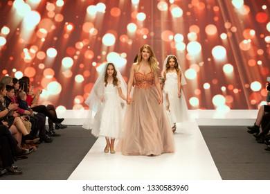 ZAGREB, CROATIA - FEBRUARY 02, 2019: Croatian actress Jelena Percin and her daughter walking down the catwalk at the Wedding fair show