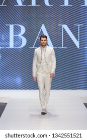 ZAGREB, CROATIA - FEBRUARY 02, 2019: Male fashion model wearing a suit on the catwalk of the Wedding fair show