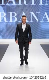 ZAGREB, CROATIA - FEBRUARY 02, 2019: Croatian singer Ivan Zak wearing a suit on the catwalk of the Wedding fair show