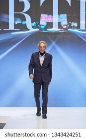 ZAGREB, CROATIA - FEBRUARY 02, 2019: Mature male fashion model wearing a suit on the catwalk of the Wedding fair show