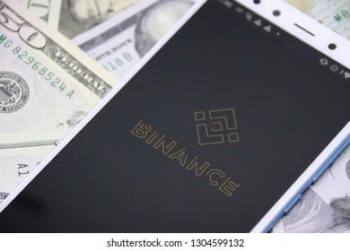 ZAGREB, CROATIA - FEBRUARY 05, 2019: Binance android app on dollar background. Binance is a finance exchange market.