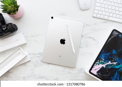 ZAGREB, CROATIA - FEBRUARY 18, 2019: The back of the Apple iPad Pro 11 inch with Apple Pencil 2 on white marble background. Newly opened silver iPad Pro 11 inch and Apple Pencil 2 surrounded by boxes.