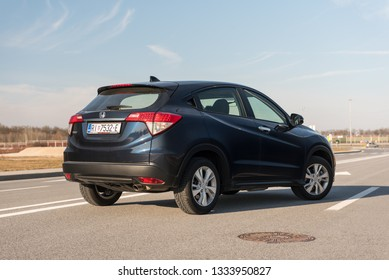 ZAGREB, CROATIA - FEBRUARY 23, 2019: New 2019. Honda SUV HR-V in dark blue colour on the city streets. Modern car. Rear view of the Honda.